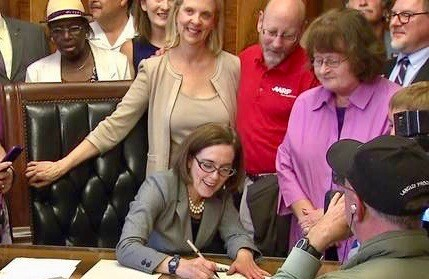 Retirement bill signing ceremony with Gov Kate Brown, Joyce DeMonnin and jerry cohen.jpeg