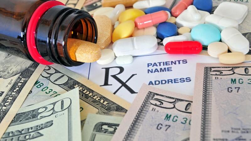 Pill bottle with money.jpg