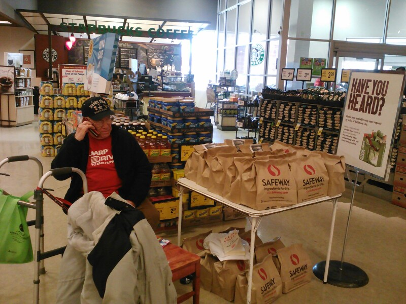 AARP Maryland volunteer Marvin Sakin volunteers at a food donation table in Baltimore.
