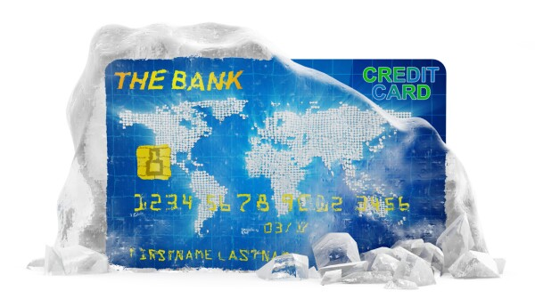 Credit Card in Broken Solid Ice Block