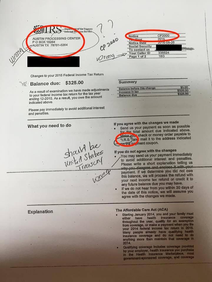 A man circles discrepancies in a fake IRS letter.