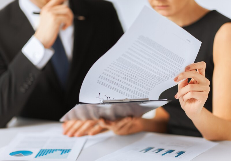 close up of business people with contract document