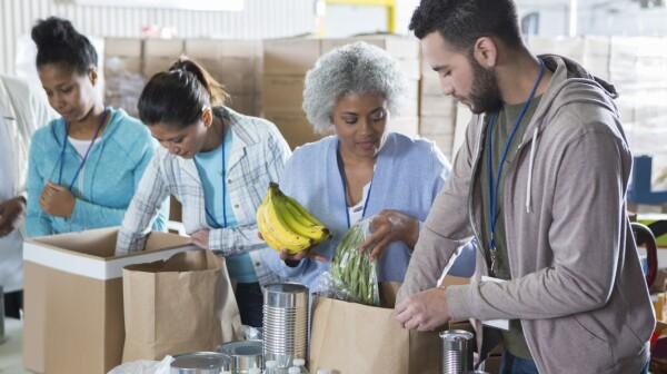 Diverse group of volunteers in food bank