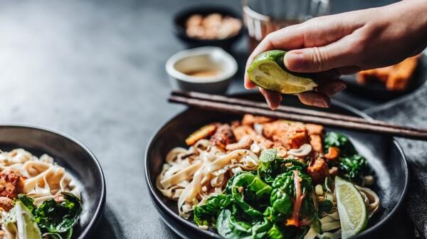 Chef adding lime to a vegan dish