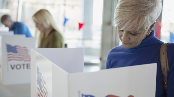 Woman in voting booth at polling place