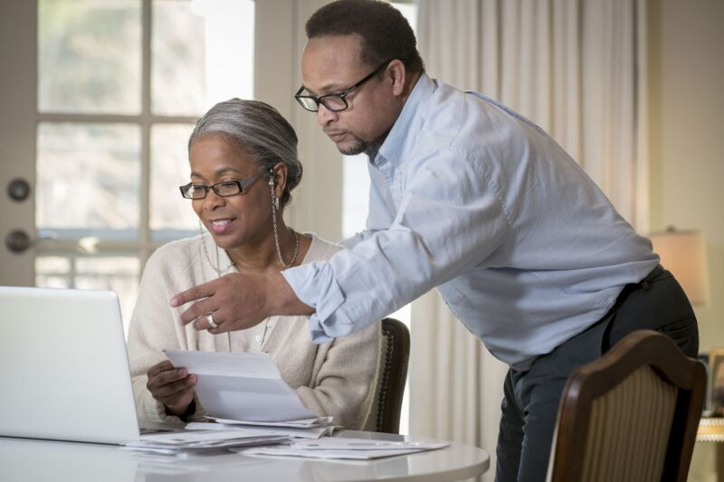 image of Black couple paying bills online 106768_39_preview.jpg