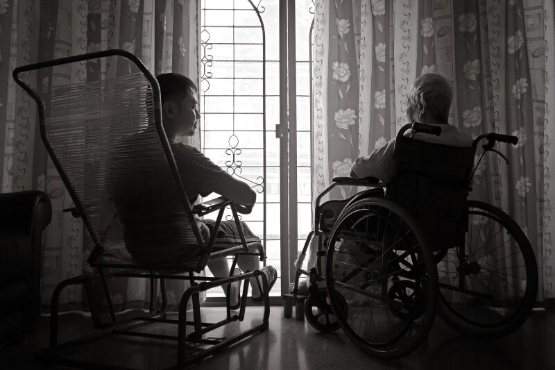 Rear View Of Men Sitting By Window