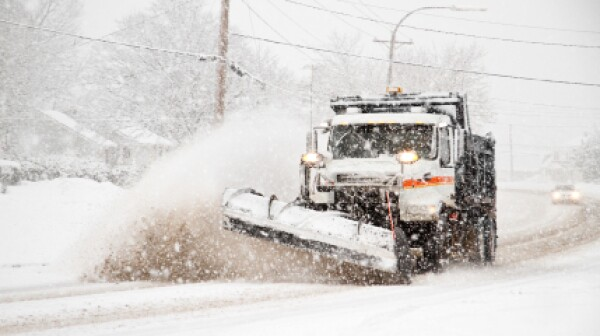 Snowplow during snowstorm_499,997