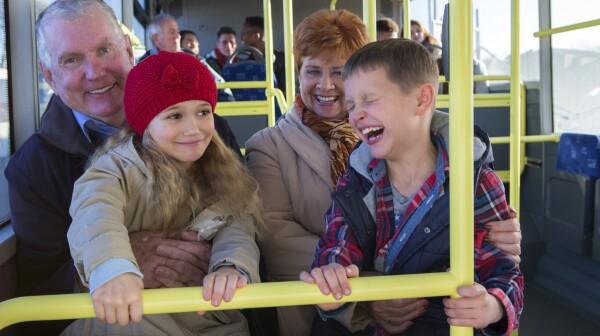 Grandparents with grandchildren on the bus