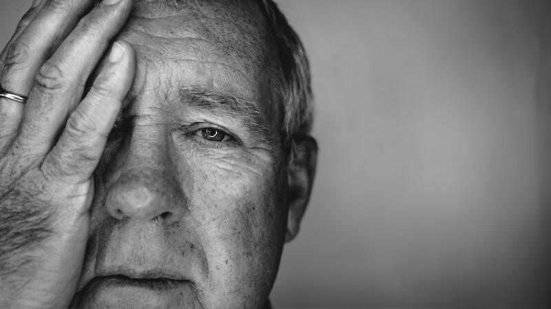 Close up face portrait Older depressed man, suicide prevention