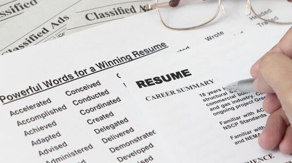 A list of words and a person writing a resume