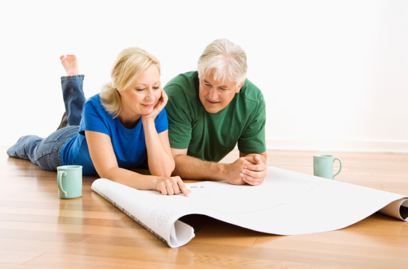 Man and woman discussing blueprints.