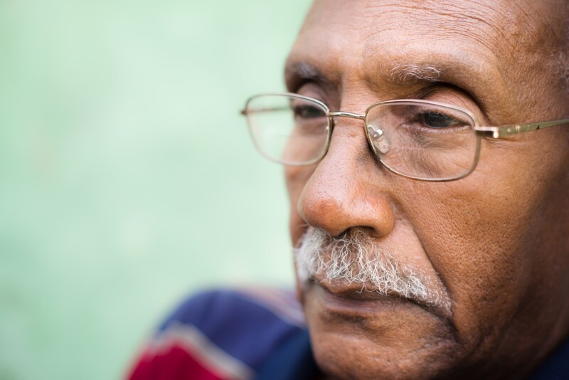 Worried senior african american man with eyeglasses
