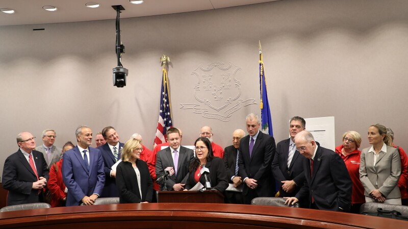 Group with Nora at podium.jpg