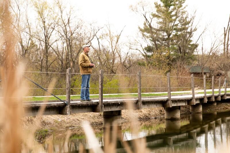 Dennis overlooks naturescape from bridge