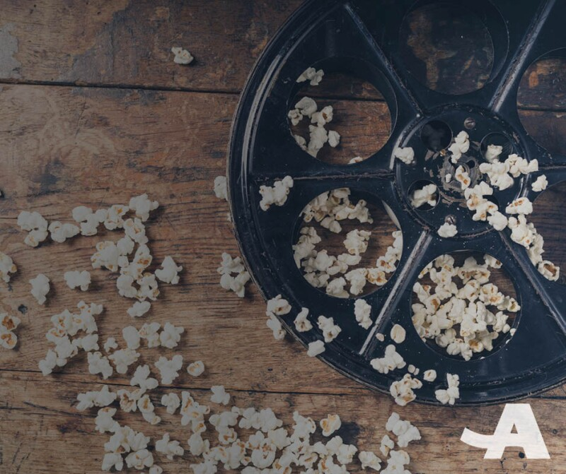 Movie reel and popcorn