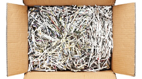 Cardboard box filled with shredded paper