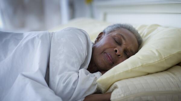 Black woman sleeping in bed