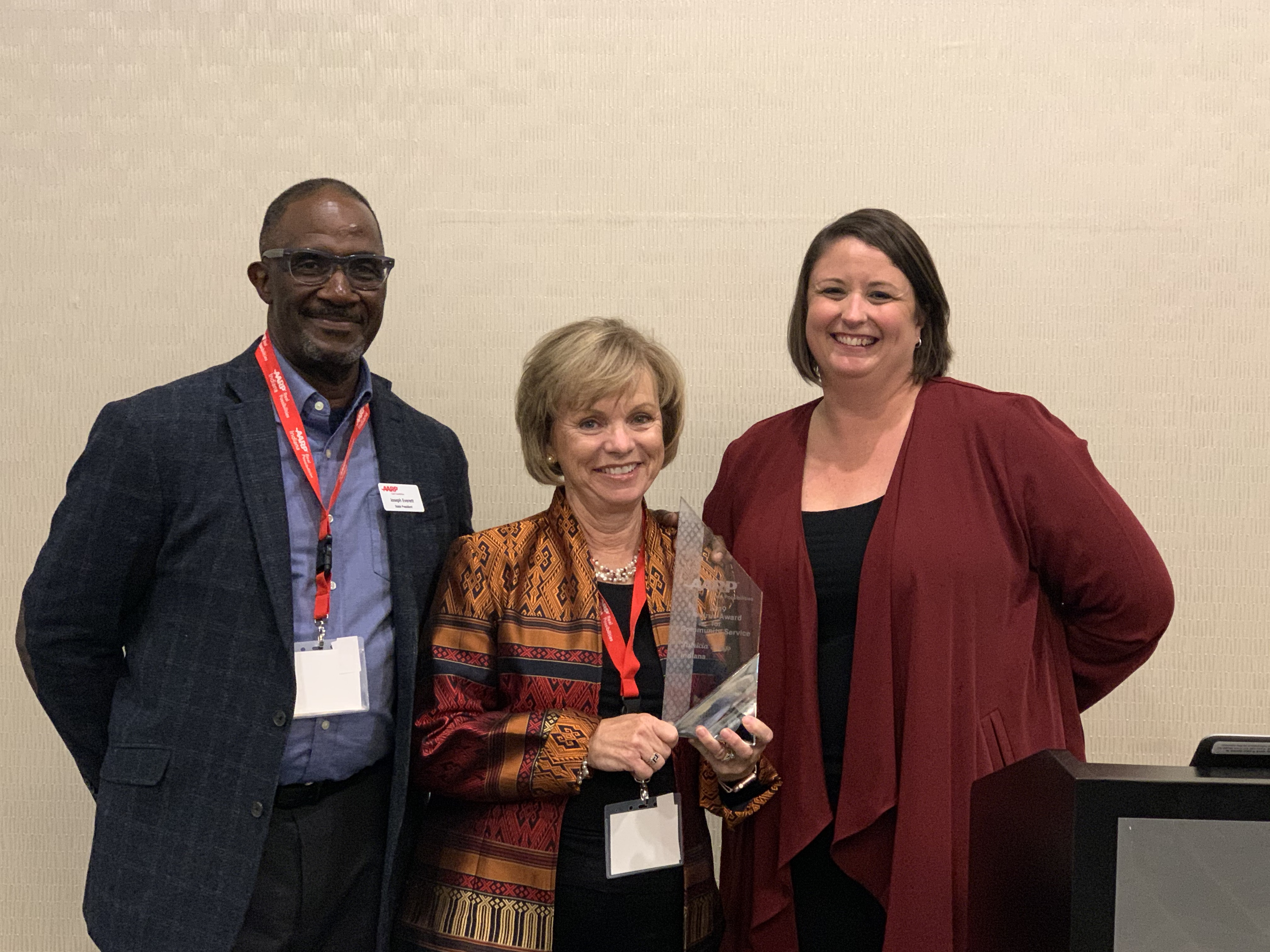 Tish Biggs received the Andrus Award and poses with AARP Indiana State President Joe Everett and State Director Sarah Waddle.