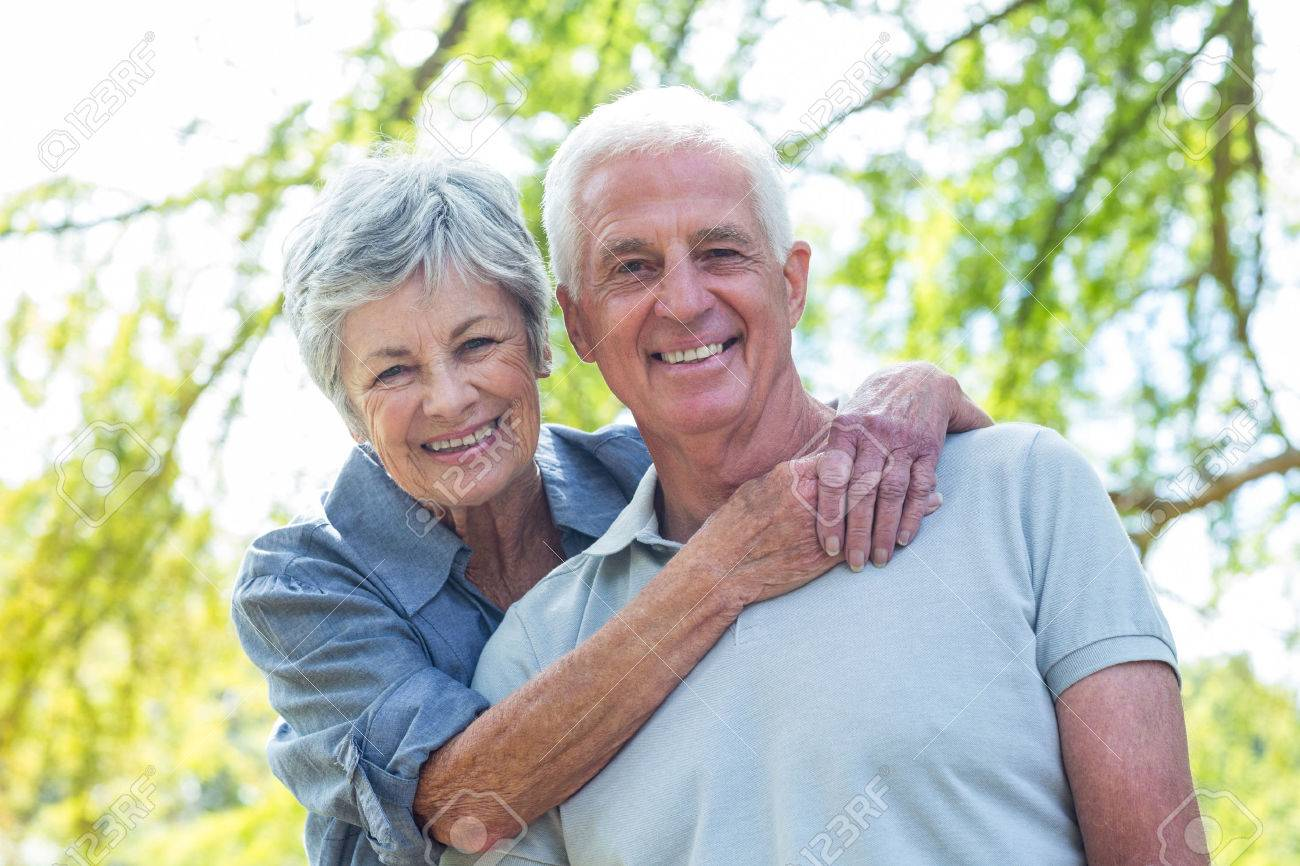 42670537-happy-old-couple-smiling-in-a-park-on-a-sunny-day.jpg